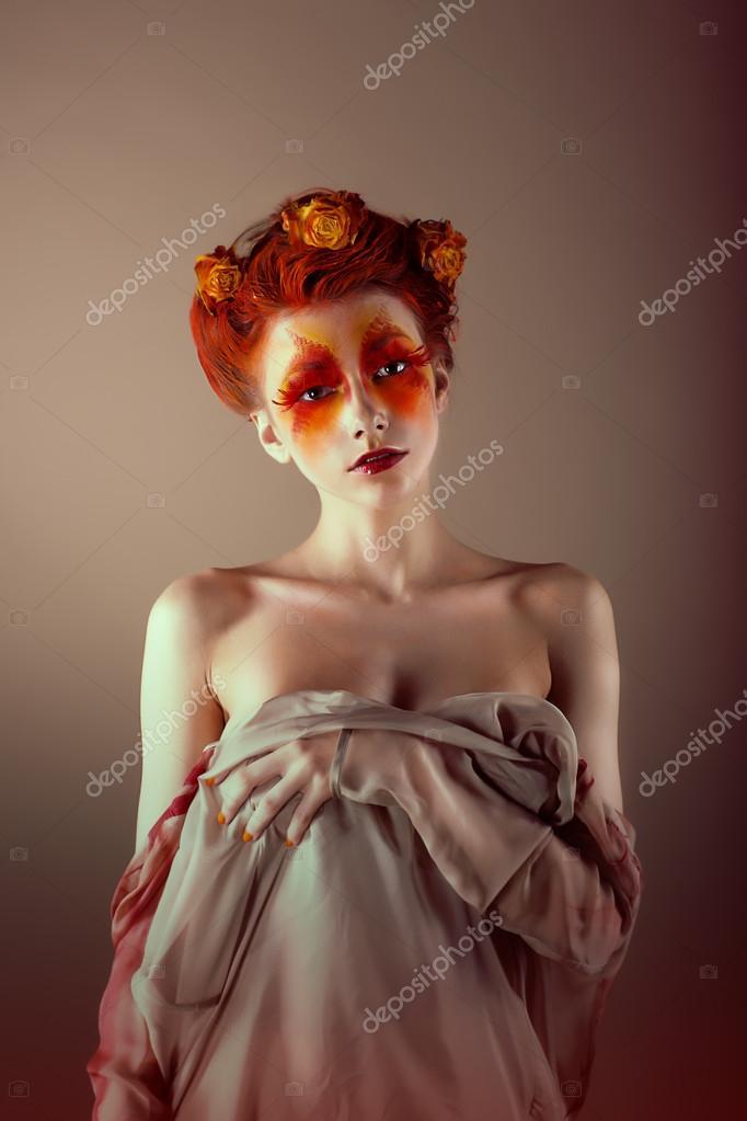 Portrait of Unusual Redhead Woman with False Red Eyelashes. Fantasy