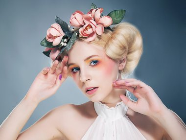 Nostalgia. Portrait of Romantic Blonde with Wreath of Flowers. Expression