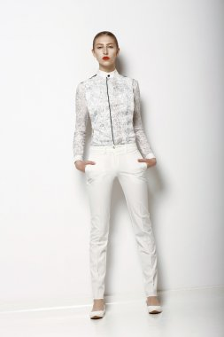 High Fashion. Trendy Woman in WHite Breeches in Graceful Pose. Spring Time Collection