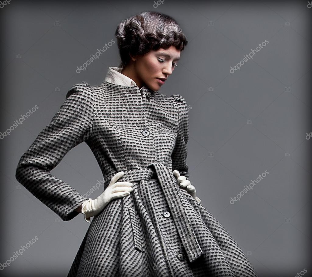 Nostalgia. Romantic Lady in Classic Coat Daydreaming. Pinup Style