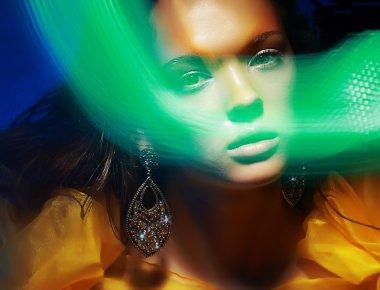 Diffuse. Fantasy. Silhouette of Woman's Face in Magic Disco Fog