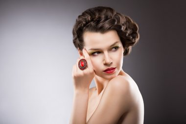 Noble Lady. Gorgeous Posh Brunette with Jewelry - Ruby Oval Ring. Braided Hairstyle