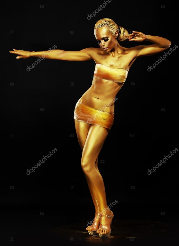 resplandor. fantasía. mujer oro realizando en club nocturno. luces ...