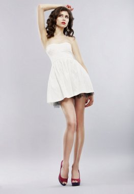 Elegance. Stylish Brunette in Light Sundress posing. Fashion Style