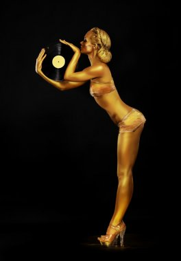 Futurism. Shapely Golden Woman DJ with Vinyl Record. Body Painting