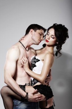 Sensuality. Affection. Beautiful Entwined Couple in Embrace