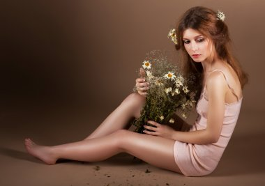 Meditation. Barefoot Genuine Woman with Bouquet of Flowers