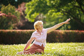 Photo Meditation. Graceful Old Woman in the Park Stretching her Hand