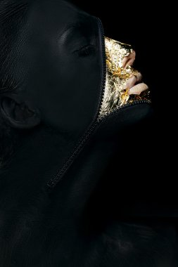 Creative Concept. Surreal Fancy Woman Painted Black with Zip Fastener on her Outlandish Face