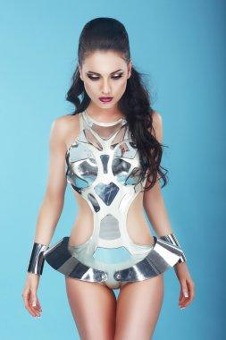 Fantasy. Glam. Extravagant Woman in Stagy Art Costume
