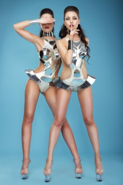 Extravagance. Two Heeled Women in Futuristic Clubwear. Hangouts