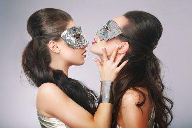 Performance. Fancy Women in Surrealistic Stylized Silver Masks