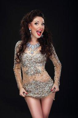 Cheerful Woman in Shiny Silver Stagy Dress Having Fun