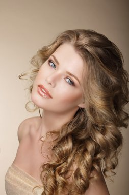 Pure Beauty. Exquisite Woman with Perfect Curly Ash-Colored Hair