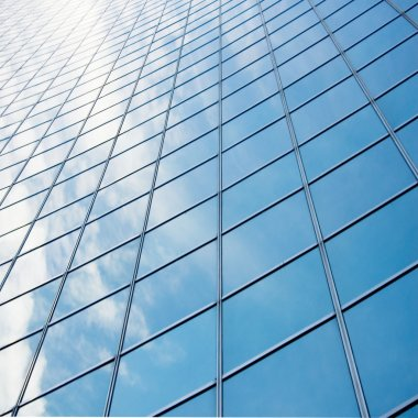reflection of sky at building glass