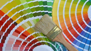 Pantone color catalog and a brush