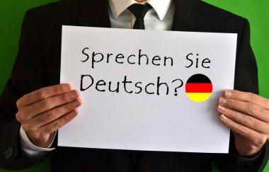 Businessman showing a sheet with text Sprechen Sie Deutsch