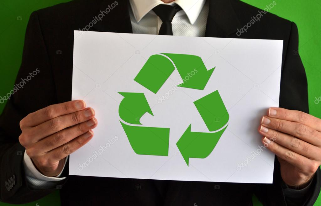 Businessman showing recycling symbol