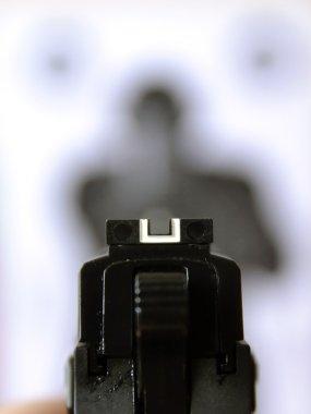 Aiming gun at target