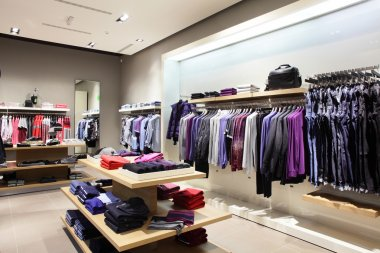Interior of brand new fashion clothes store stock vector