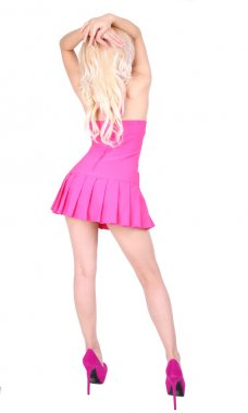 Backside of dancing blonde woman in short pink dress and high heels on her sexy legs isolated on white