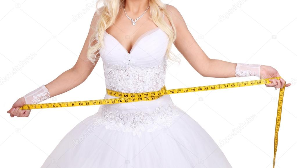 Bride measuring her wedding dress isolated on white
