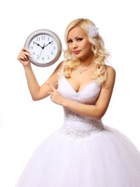 bride with wall clock. beautiful blonde young woman waiting for the groom isolated on white background