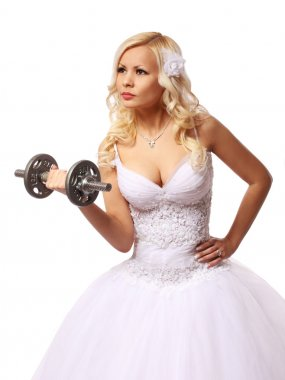 bride with dumbbell. beautiful blonde young woman in wedding dress isolated on white, concept