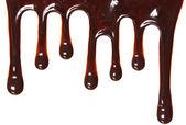 Fotografie Schokolade-Streams isoliert auf weißem Hintergrund