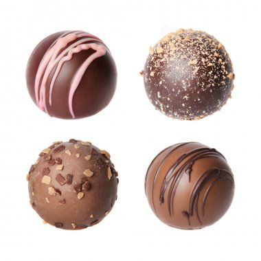Chocolate candies collection. Beautiful Belgian truffles isolated on white background