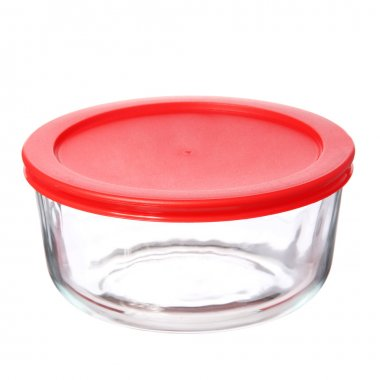Glass food container with red plastic lid isolated on white background