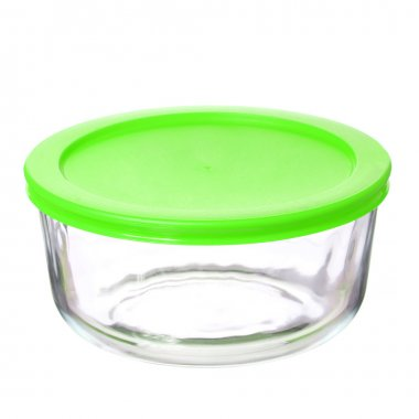 Glass food container with green plastic lid isolated on white background