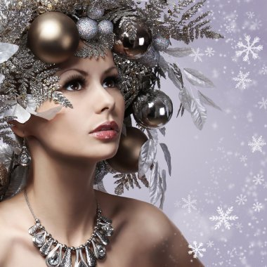 Christmas Woman with New Year Decorated Hairstyle. Snow Queen. P