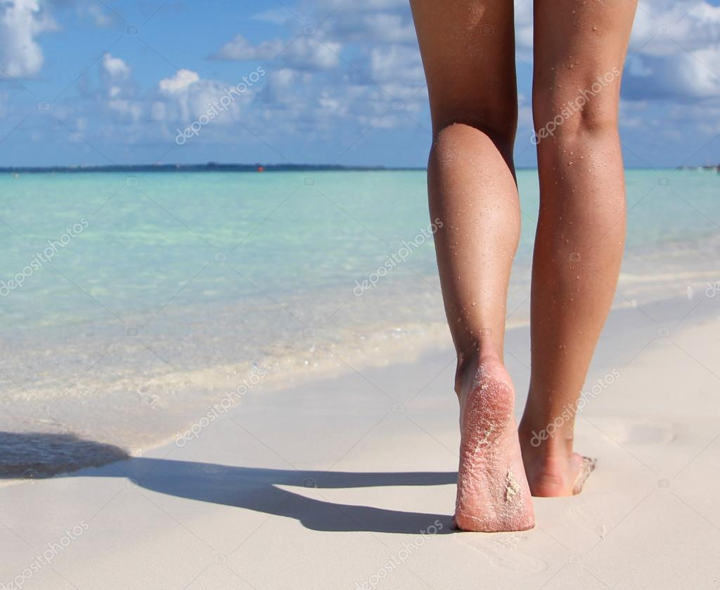 Sexy Legs on Tropical Sand Beach. Walking Female Feet. Closeup