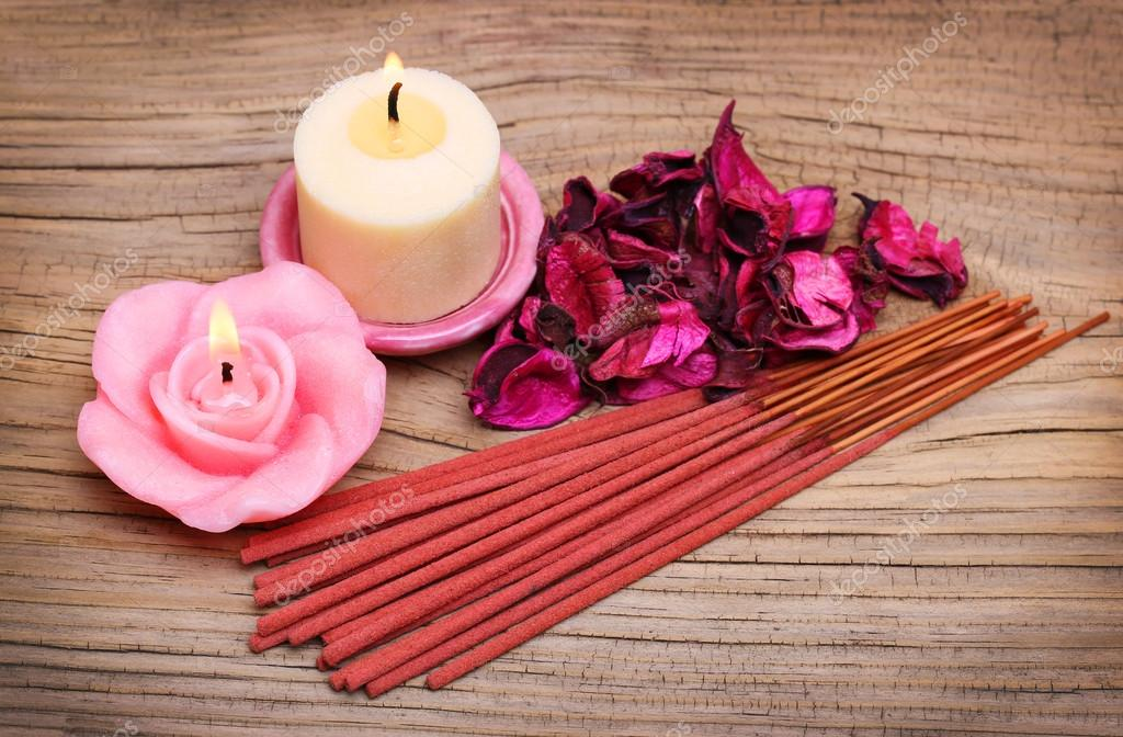 Spa Set. Burning candles with roses dried leaves and incense sti
