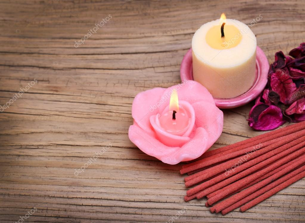Spa. Burning candles with dried roses leaves and incense sticks