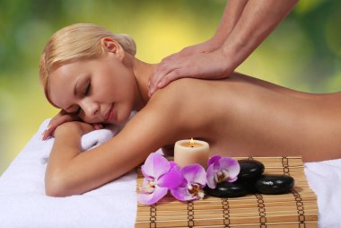 Spa Massage. Beautiful Blonde Woman Getting Body Massage.