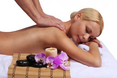 Spa Massage. Beautiful Blonde Woman Getting Body Massage