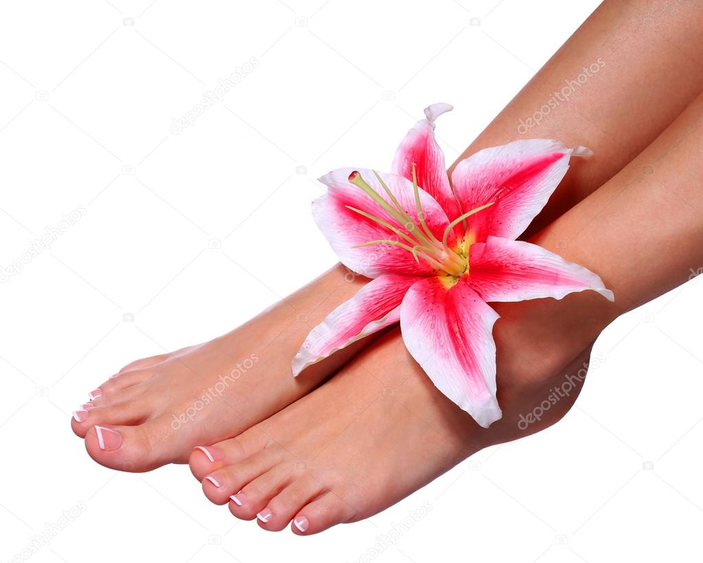 Pedicure. Beautiful female feet with french manicure