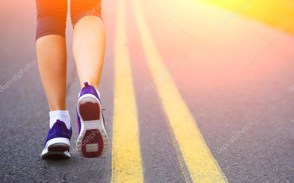 Runner Female Feet Running on Road. Jog