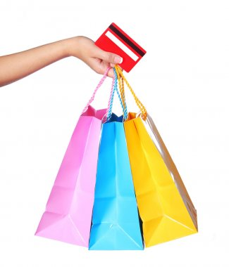 Female Hand Holding Colorful Shopping Bags and Credit Card