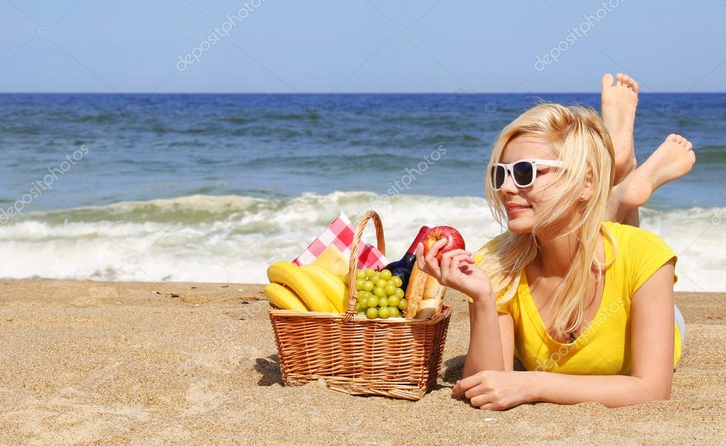 Picnic on the Beach. Blonde Young Woman with Basket