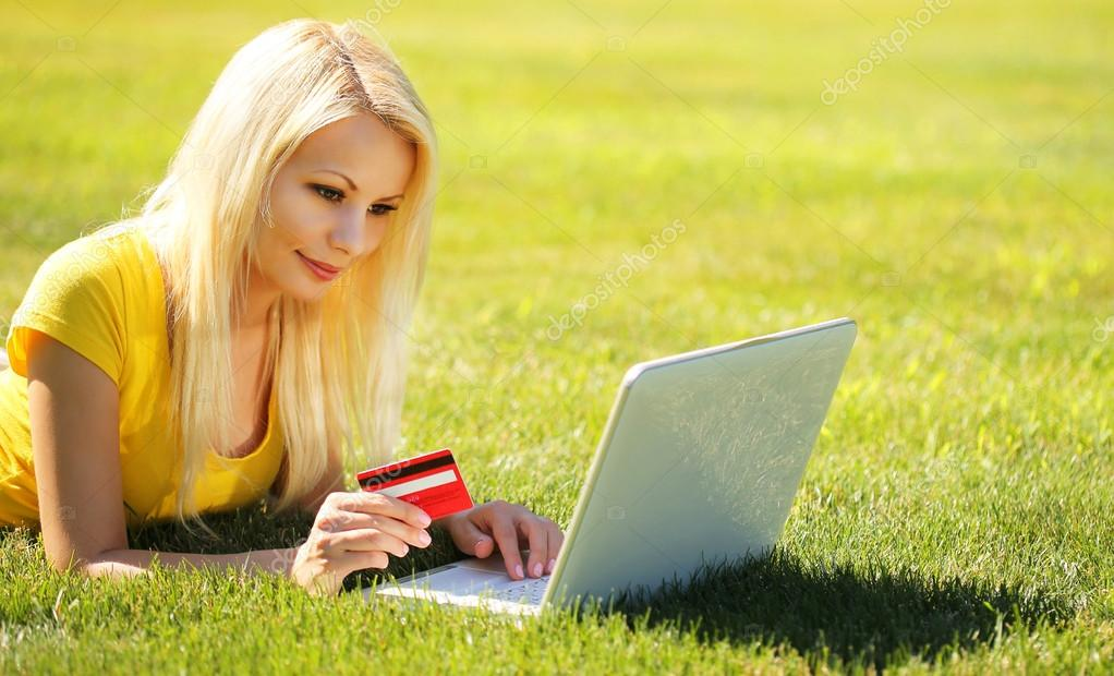 Online Shopping. Smiling Blonde Girl with Laptop