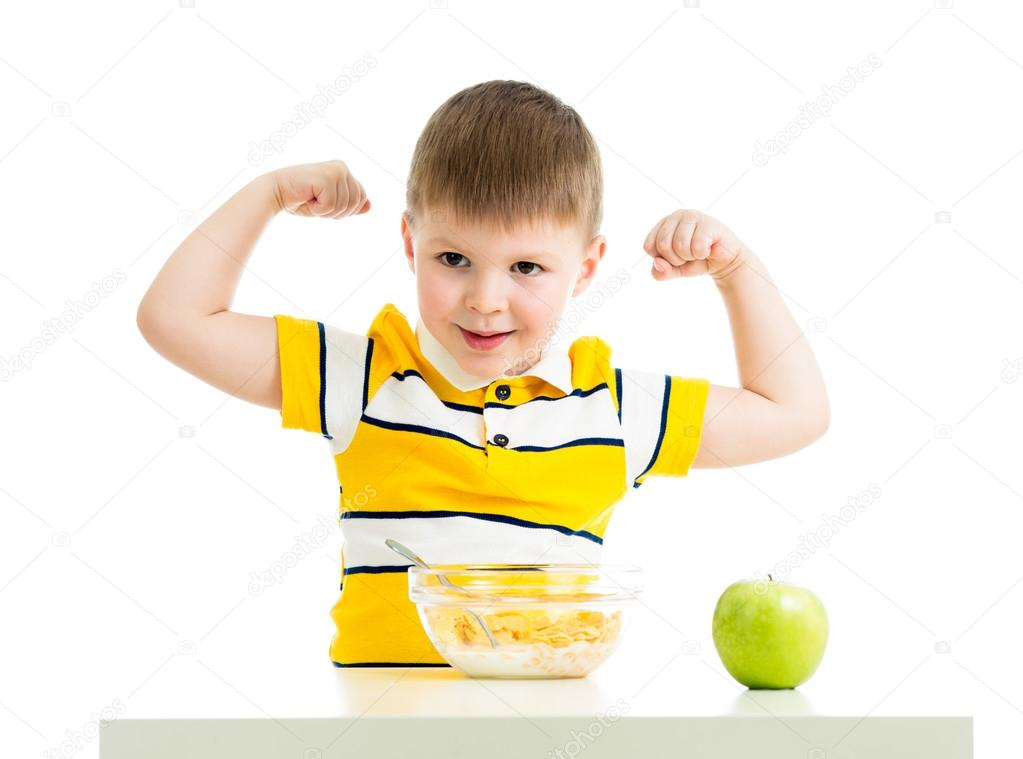kid boy eating healthy food and showing strength — Stock ...