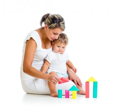 Mother and her baby playing building blocks toy