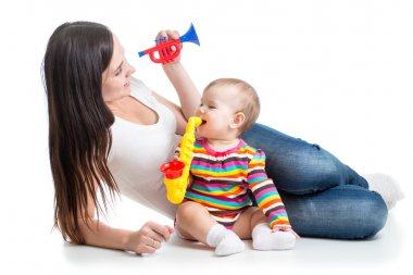 Baby and mom play musical toys