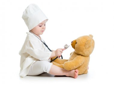 kid girl playing doctor with toy