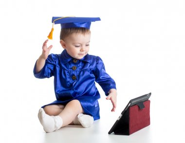 baby with academic clothes playing tablet PC