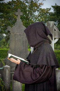 Hooded prayer
