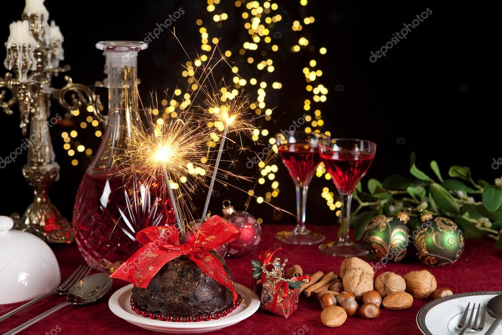 Christmas Pudding On Fire.Christmas Pudding And Sparkling Fire Stock Photo
